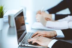 Group of business people working together in office. Man hands typing on laptop computer stock images