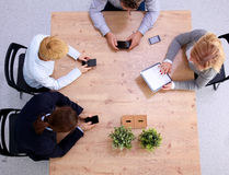 Group of business people working together on white Stock Photography