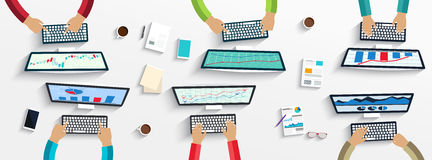 Group of business people working using digital devices on laptops, computers Royalty Free Stock Photo