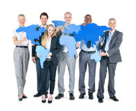 Group of Business People World Map.  Royalty Free Stock Photos