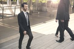 Group of business person walking on stairs. rush hour. Concept Royalty Free Stock Photos