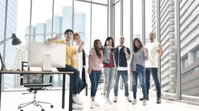 Group of business persons standing together. In the office looking happy, confident and inspiring Stock Image
