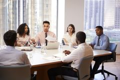Group Of Business Professionals Meeting Around Table In Modern Office royalty free stock images
