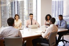 Group Of Business Professionals Meeting Around Table In Modern Office royalty free stock image