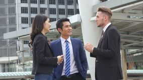 Group Business talk with feeling confident and freedom at outdoor. The group Business talk with feeling confident and freedom stock video