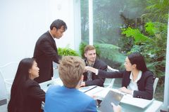 Group of business team people shaking hand with success, agreement of discussion with handshake after meeting in royalty free stock images