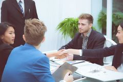 Group of business team people shaking hand with success, agreement of discussion stock photo