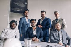 Group of business team standing in a row royalty free stock photo