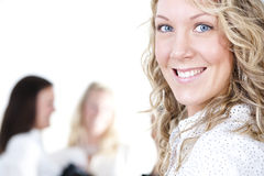 Group of business women. At the office working - Pretty caucasian woman in front Royalty Free Stock Photos