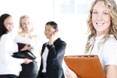 Group of business women. At the office working - Pretty caucasian woman in front Royalty Free Stock Images