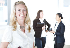 Group of business women. At the office working - Pretty caucasian woman in front Royalty Free Stock Image
