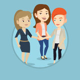 Group of business women joining hands. Royalty Free Stock Images