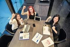Group of business women meeting in a meeting room with blank scr. Een, sharing their ideas, Multi ethnic Stock Photos