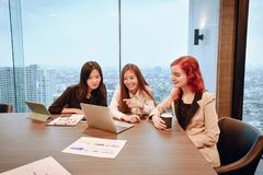 Group of business women meeting in a meeting room with blank scr. Een, sharing their ideas, Multi ethnic Stock Image