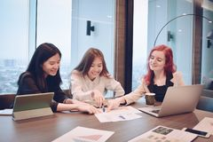 Group of business women meeting in a meeting room with blank scr. Een, sharing their ideas, Multi ethnic Royalty Free Stock Image