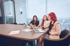 Group of business women meeting in a meeting room with blank scr. Een, sharing their ideas, Multi ethnic Stock Images