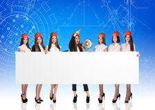 Group of business women with white board Royalty Free Stock Photos