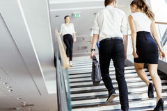 Group of businessman walking and taking stairs stock photos