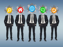 Group of businessmen with application icons instead of their hea Stock Photography