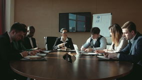 A group of businessmen at business meeting stock video footage