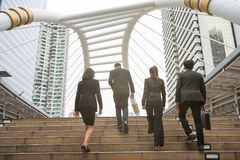 Business team walking in city Stock Images