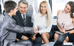Group of businessmen discussing the policies the company shaking hands with each other Royalty Free Stock Photo