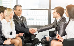 Group of businessmen discussing the policies  the company shaking hands with each other Stock Photos
