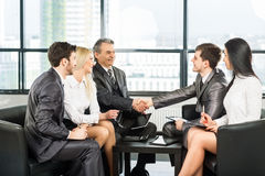 A group of businessmen discussing Royalty Free Stock Photo