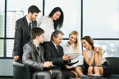 A group of businessmen discussing Stock Image
