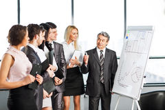A group of businessmen discussing the policy of the company in t Stock Photography