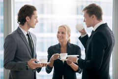 Group of businessmen having tea after meeting. Group of businessmen having tea in office after meeting, provide good employment conditions for employees, co royalty free stock images
