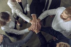 Business people putting their hands together. Concept of integration, teamwork and partnership. Group of businessmen make an agreement in the office stock image