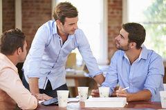 Group Of Businessmen Meeting To Discuss Ideas Stock Images