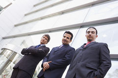 Group of businessmen outside office building. Group of businessment outside modern office building Stock Image