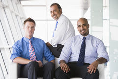 Group of businessmen sitting in lobby Stock Photo