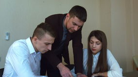Group of businessmen are standing around a table stock footage