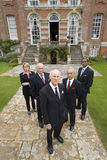 Group of businessmen and woman by manor house, portrait, elevated view Stock Photography