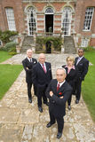 Group of businessmen and woman by manor house, portrait, elevated view royalty free stock images