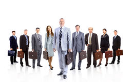 A group of businesspeople. Their leader is on the front stock photos