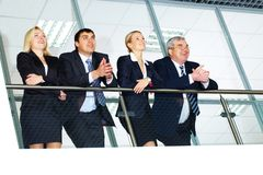 Group of businesspeople. And their senior boss standing by banisters Stock Photography