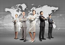 Group of businesspeople. Image of businesspeople standing against world map background royalty free stock photo