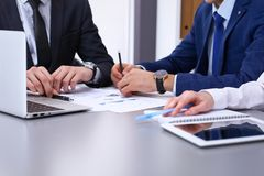 Group of businesspeople analyzing financial documents.  Business team at meeting. Group of businesspeople analyzing financial documents. Business team at meeting Royalty Free Stock Image