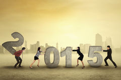 Group of businesspeople arrange number 2015 Stock Photography