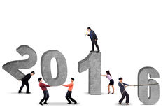 Group of businesspeople arrange numbers 2016 Stock Image