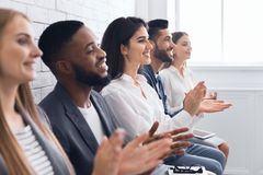 Group of businesspeople clapping hands at meeting. Presentation stock photography