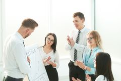 Group of businesspeople clapping hands during meeting presentation. Business and education stock photo