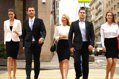 Group Of Businesspeople Crossing Street. Full length portrait of a Group Of Businesspeople Crossing Summer Street Stock Image