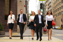 Group Of Businesspeople Crossing Street. Full length portrait of a Group Of Businesspeople Crossing Summer Street Stock Photos