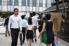 Group Of Businesspeople Crossing Street. Singapore - 01 November 2014: Group Of Businesspeople Crossing Street Stock Photo