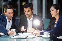 Group of businesspeople discussing over digital tablet Stock Image